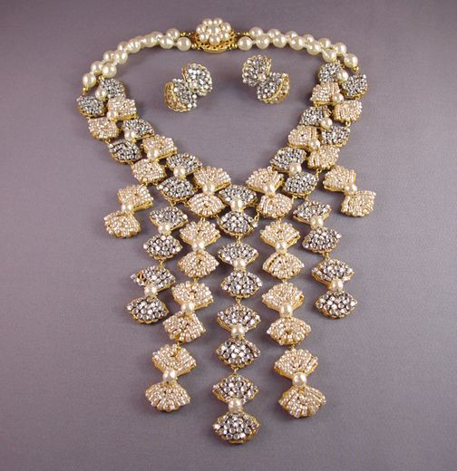 MIRIAM HASKELL huge bib necklace and matching pierced earrings made up of many small bows in white baroque artificial seed pearls and clear rose montee with glass pearls, all set in gold tone filigree. This peice was designed by and purchased from Millie Petronzio circa 1996, this is entirely hand made one piece at at time /1698