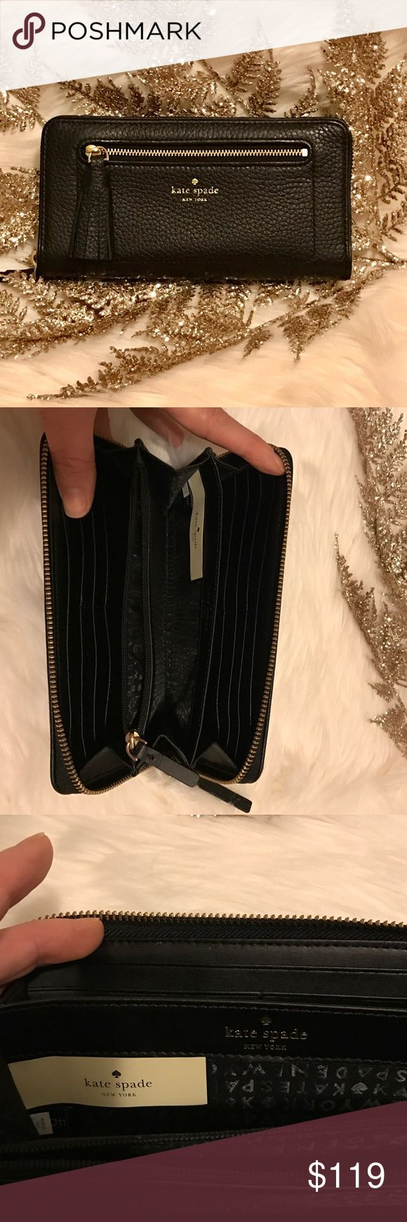 🎁🚨🤗HP 11/27🤗♠️Kate Spade tassel wallet This is a brand new with tags gorgeous wallet! It is made of full grain leather, with a fun tassel on the front pocket zipper pull. It is a full zip around to keep everything secure. 12 card slots, coin pocket, and tons of space. I can fit my iPhone 7 plus inside and zip it up fully. 🎉🎁🤗Host Pick for Simply Chic Party 11/27!🤗🎁🎉 kate spade Bags Wallets