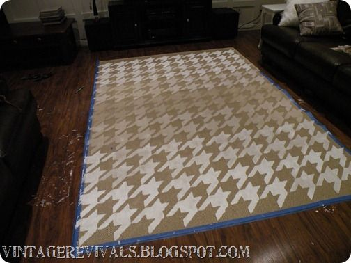 $20 dollar rug from Walmart, some fabric paint and you have an awesome looking rug.