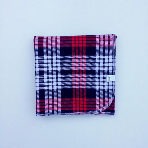 Wrap them in love and comfort.  Tiny little toes, tiny little fingernails, soft little breaths. An essential piece that you will use every day and take everywhere.  - XL Burp Cloth - Swaddle Blanket - Receiving Blanket - Single Layer (fold for more absorbency) The beautiful red, black, and white plaid looks wonderful throughout the autumn and winter, and makes a fantastic photo prop for Christmas babies.  100% Cotton Flanelette 32 Square Pattern is printed on one side  Care: Machine wash…