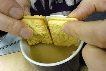 Official Rule Number 25. Biscuits dunked into tea or coffee have next to no calories as the hot liquid destroys them.   http://www.smashwords.com/books/view/258802