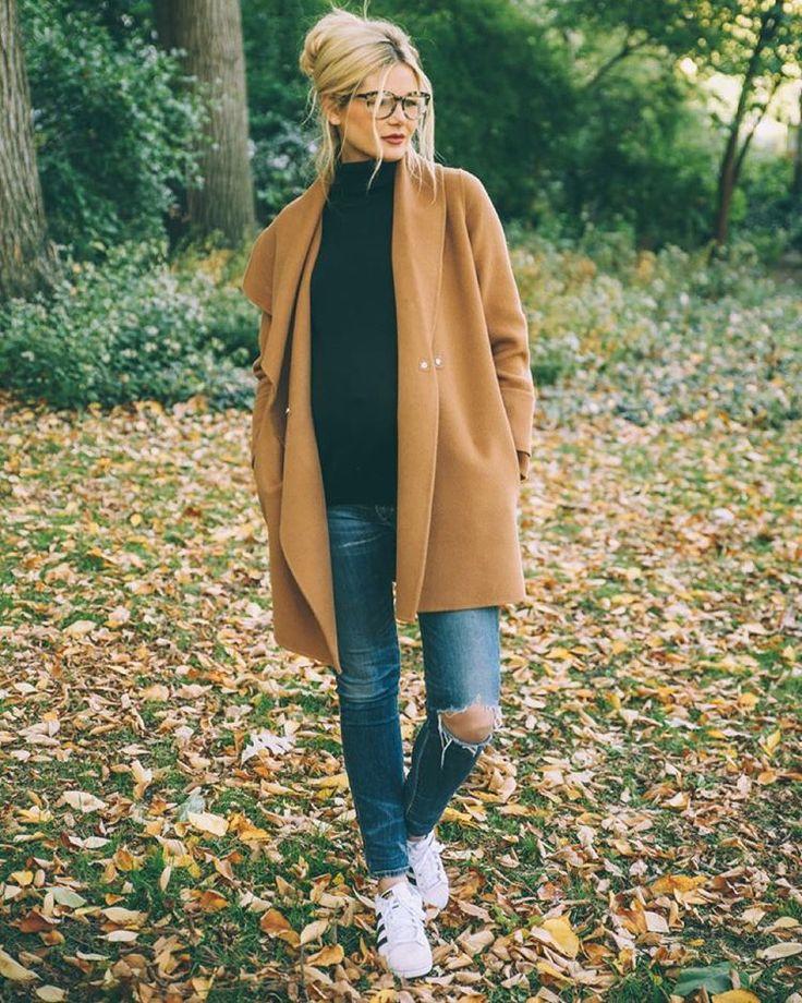 Black bebe turtleneck, camel VS coat, straight leg jeans, SEE glasses