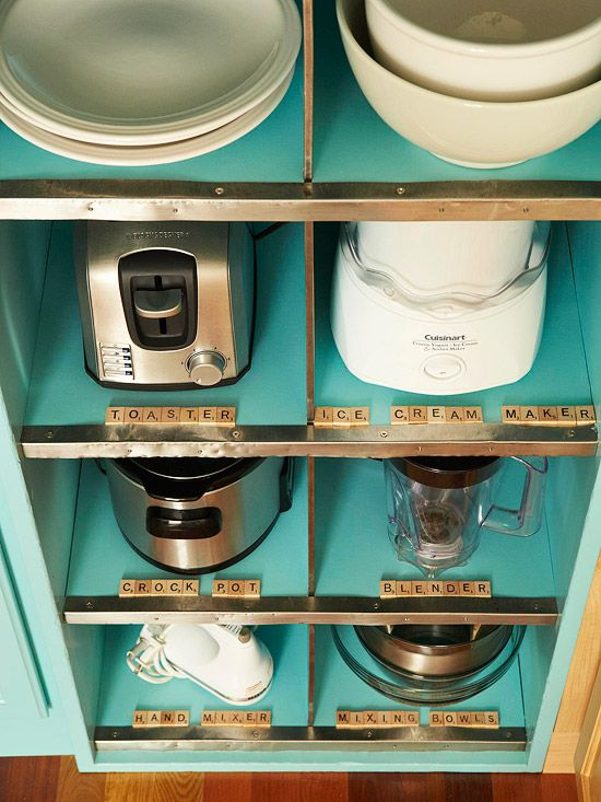 Give order to a collection of small appliances with a system of cubbies. Tuck in the necessary attachments and manuals that accompany each appliance so everything is on hand...i couldn't do the scrabble tiles, they would be broken in a minute, but i like the label idea!