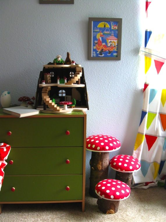 these mushroom stools would be easier to make than you might think: use logs or a portion of a small tree trunk, stick a round piece of wood on top, and then cover with polka dot fabric and stuff with batting