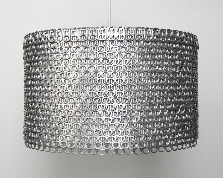 Cola tabs make this lamp shade look armored. Nasty!