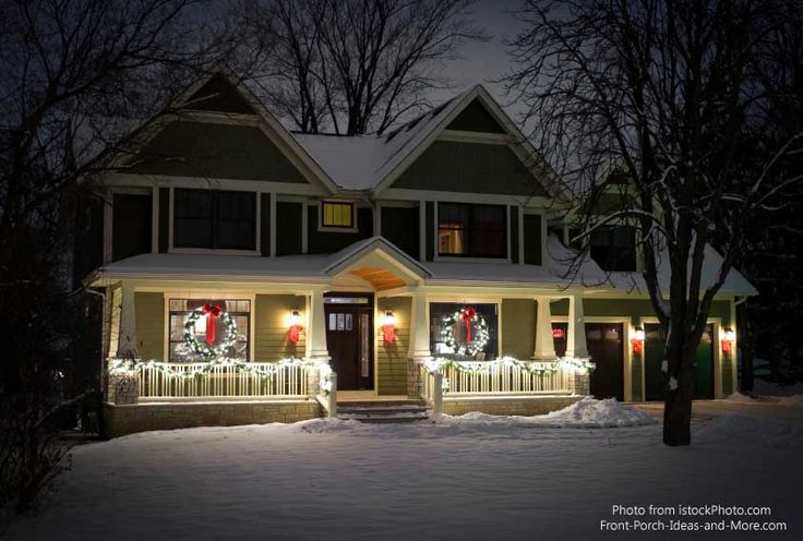 Lighted Christmas wreaths & garlands create a serene winter scene. More lighting ideas at: http://www.front-porch-ideas-and-more.com/outdoor-christmas-decorations.html