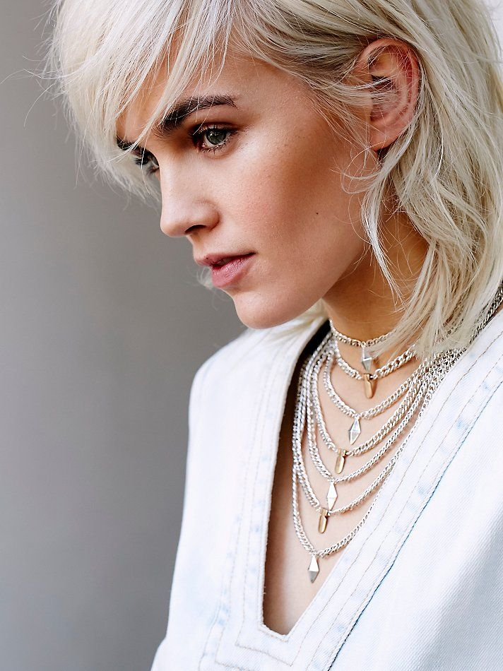 High Vibrations Statement Choker | In a modern design, this multi-tiered metal choker features different charm detailing on each layer. Adjustable lobster clasp closure.