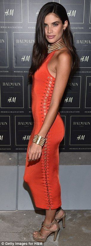Red hot: Sara Sampaio showed off her figure in a clinging cherry-coloured dress...