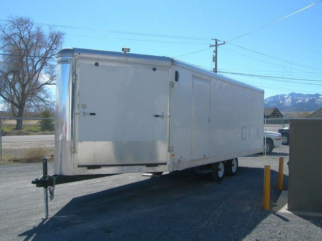 2015 Haulmark trailer. Measures from the tongue to the back, 30 foot, loading doors are 7 foot high. Has a vinyl floor with tie downs and nicely finished inside with lights.. will take four long track sleds or a Rhino and a four seat Rzr with still some room. Tires are in great condition.Trailer is in great condition and NOT beat up.Have the tittle in hand. No Scammers or trades. cash only. Calls only,  435 884 6916 or 435 884 0810 and ask for Dave.
