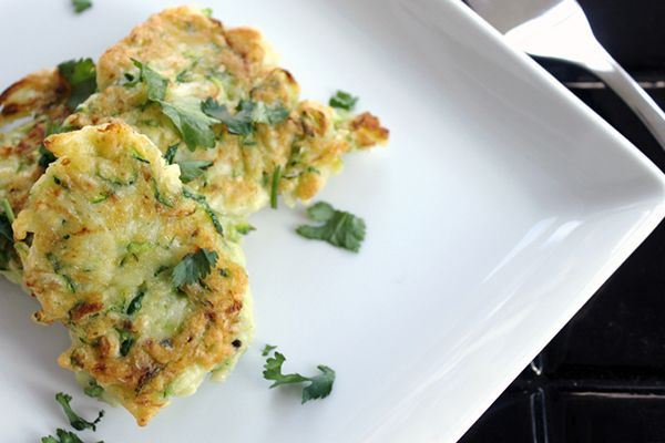 Baked Zucchini Fritters is an easy to make and have a crisp texture that you love! #zucchinifritters #zucchinirecipes #cleaneatingrecipes