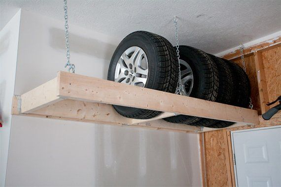 Hang a rack from the ceiling to store heavy items up and away in the garage.