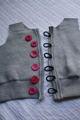 Use hair elastics as loops for buttons on refashioned hoody