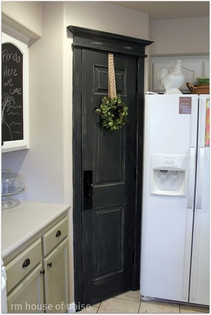 love the rustic door to a pantry or closet. but i will have stainless steal appliances.... :)