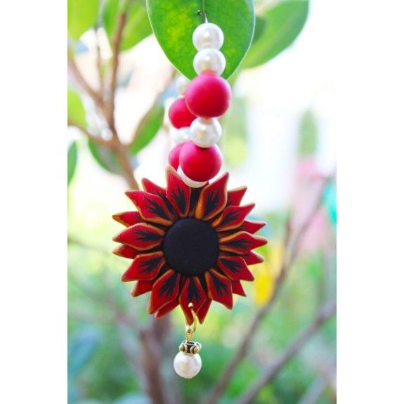 We took our expertise in polymer a few notches higher and this fall, we hereby present before you, the fragrance of Italy's thousand flowers trapped within the warmth of an Indian soul.  Dimensions - Hoop Diameter: 5cms; Length: 10.5cms approximately  Weight : 32gms (16 gms each)  Colour: Red, Black, Gold and White  Material - Polymer Clay  Closure - Hoops  Finish - Handcrafted