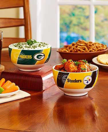 Keep hungry stomachs satisfied every Sunday with the NFL GameTime Bowl. The exterior features your team's colors, name and logo with thick, diagonal stripes in the background. 20 oz. Ceramic. Dishwasher and microwave safe.