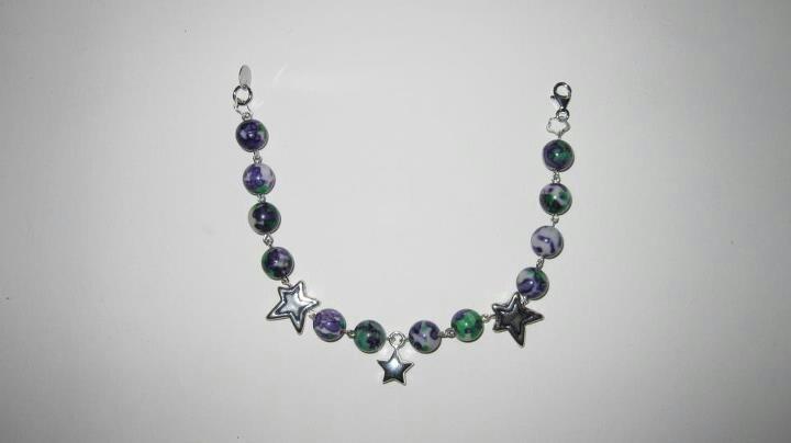 Bracciale in argento e Howlite, pendente centrale campanellino chiama angeli in argento www.facebook.com/VioletArtBijoux