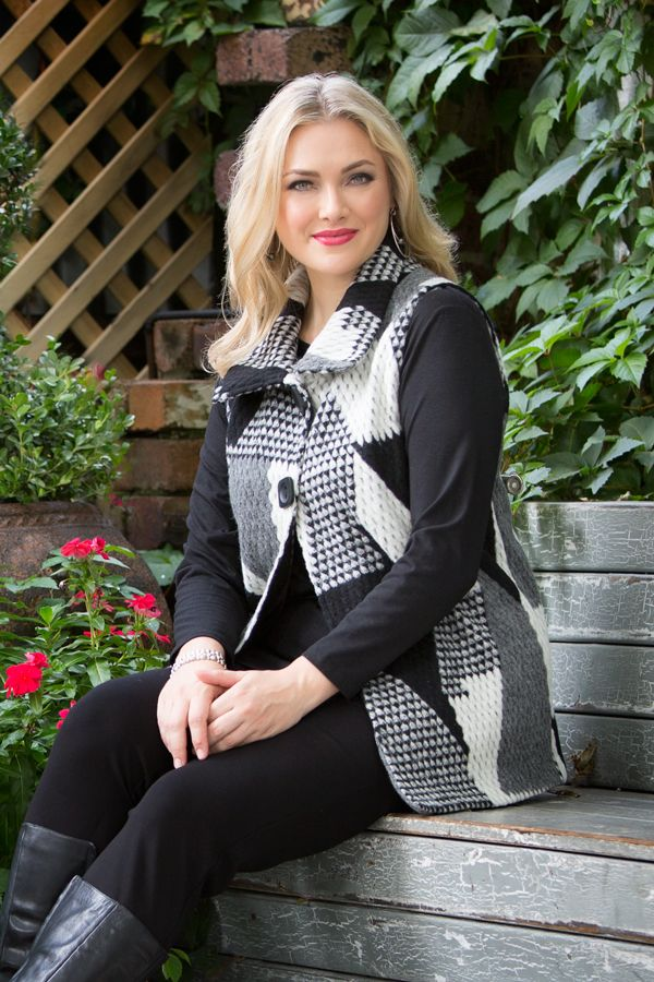 6612 Triangles Vest - This vest is a staple to your 2016 winter wardrobe. The shades of grey within the triangle pattern create an artistic, yet versatile look for winter. Features two large square black buttons to close, a wing collar and sleeveless design.