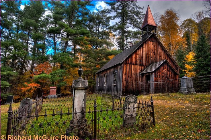 Rockingham Church and St. Leonard's Anglican Cemetery, eastern Ontario. This small wooden chuch sits atop a hill by an old cemetery at Rockingham, off the Opeongo settlement road. On a weekend in mid-October, it was brilliant with autumn colours.