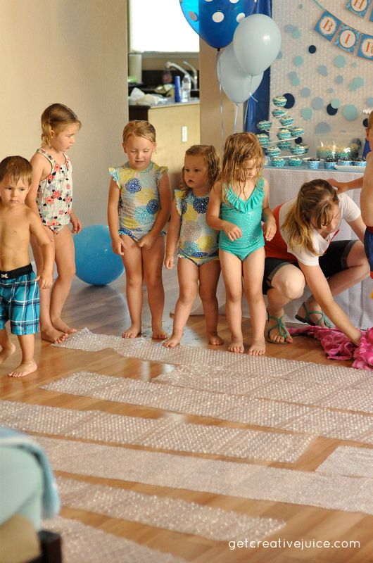 BUBBLE WRAP JUMP – this is seriously the easiest thing ever. and they LOVED it!! i bought some rolls of the large bubble wrap and placed them on the floor while the kids were out enjoying the activities outside. when they came back in for food and cupcakes it was ready to go! we gave them a count down and then it was a mad house! there may have been a few scared babies (and maybe a kid or two as well lol) but everyone else had a blast!!! simple. easy. awesome.