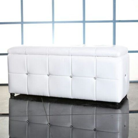 This elegant ottoman is carefully crafted in synthetic white leather with a tufted look. Crystal accents add the perfect touch.