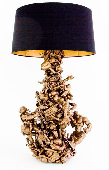 so cool ! take all sorts of little toys, glue over top of a lamp and spray paint them gold ! Would be really cool with army men!