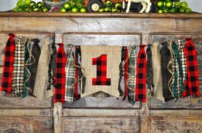 Lumberjack camp woodland deer party, first 1st birthday highchair rag banner, black and red buffalo plaid flannel & burlap photo prop by GiddyGumdrops on Etsy https://www.etsy.com/listing/479609404/lumberjack-camp-woodland-deer-party