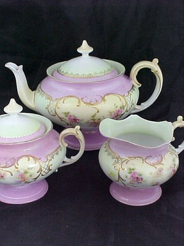 Vintage teapot, sugar bowl, and cream pitcher.