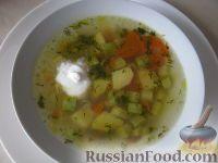 Фото к рецепту: Суп рисовый с кабачками