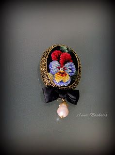 a cross stitch brooch