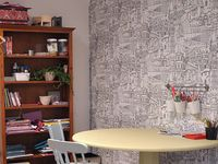 The office has a feature wall of colouring-in wallpaper, from the Kids and Teens 2016 range available from Resene ColorShops. It's perfect for the couple's three kids to scribble on.