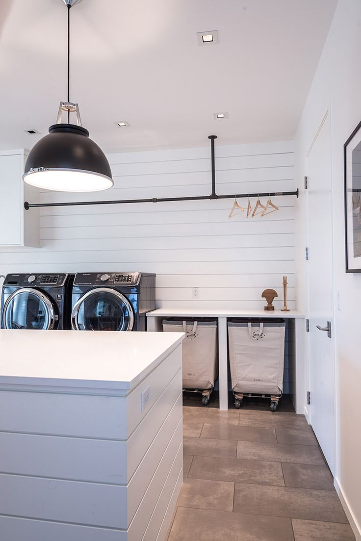 White modern laundry room featuring Steele Canvas Hampers.