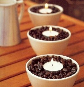 Place vanilla scented tea lights in a bowl of coffee beans. The