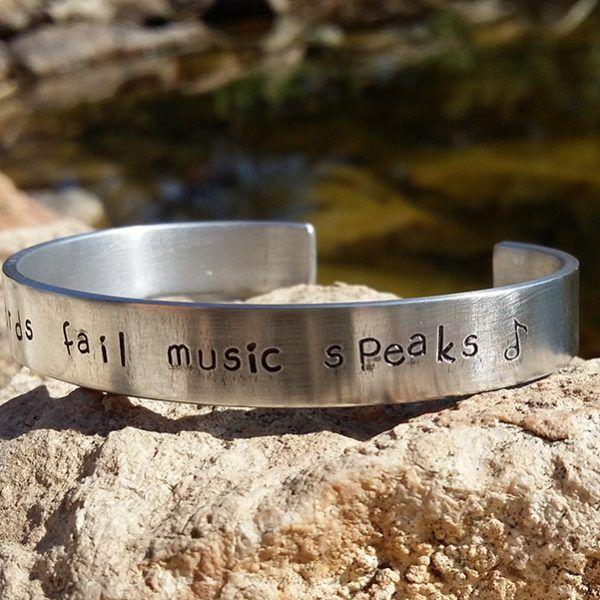 "Alumínium hangjegyes karperec ""Music speaks"""
