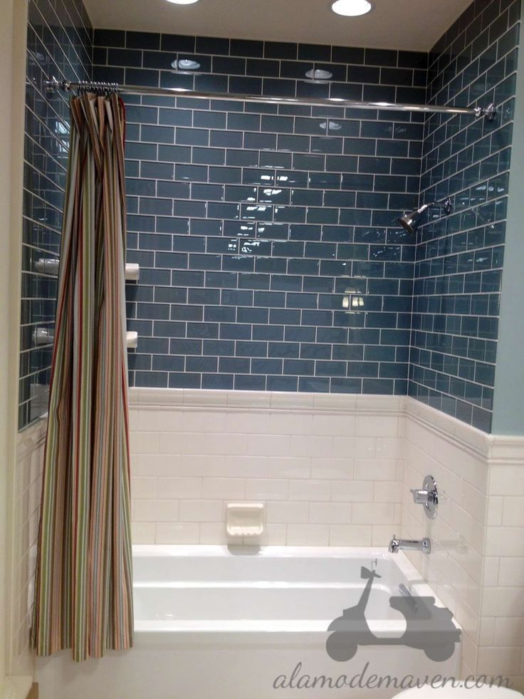 White Subway Tile Halfway Up Wall In Kids Bathroom And Then Blue Glass Subway Tile In Shower Lighter Blue Than This One Though