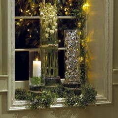 Lifestyle author Christopher Lowell uses different-size cylinders combined with candles, greenery and ornaments for a fast, festive touch.