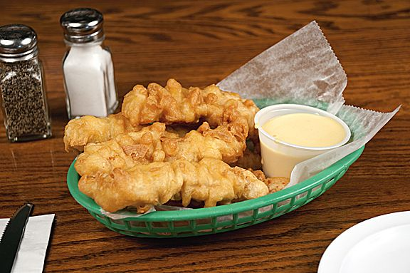 Freshly cut CHICKEN FINGERS deep fried in our secret homemade batter, served with homemade Honey Mustard or BBQ Sauce. #worldfamous #chickenfingers #villagetavern #carolstream #homecooking
