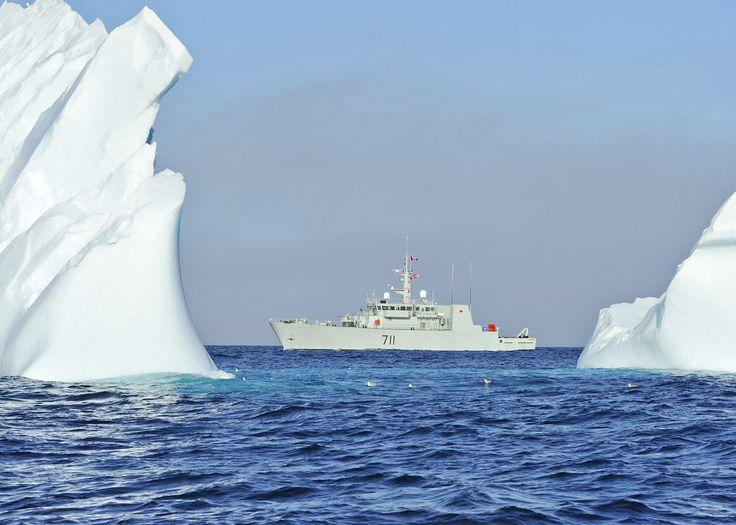 HMCS Summerside sails past an iceberg