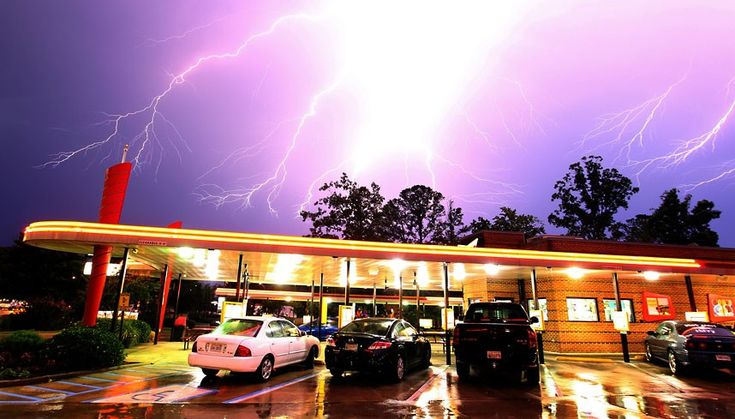 Lightning streaks across the sky over Sonic restaurant in Newport News, Virginia, US. Violent storms hit the eastern US with high winds and downed trees, killing at least 13 people and leaving three million without power during a heat wave.Picture: MCT /Landov / Barcroft Media    from The Telegraph