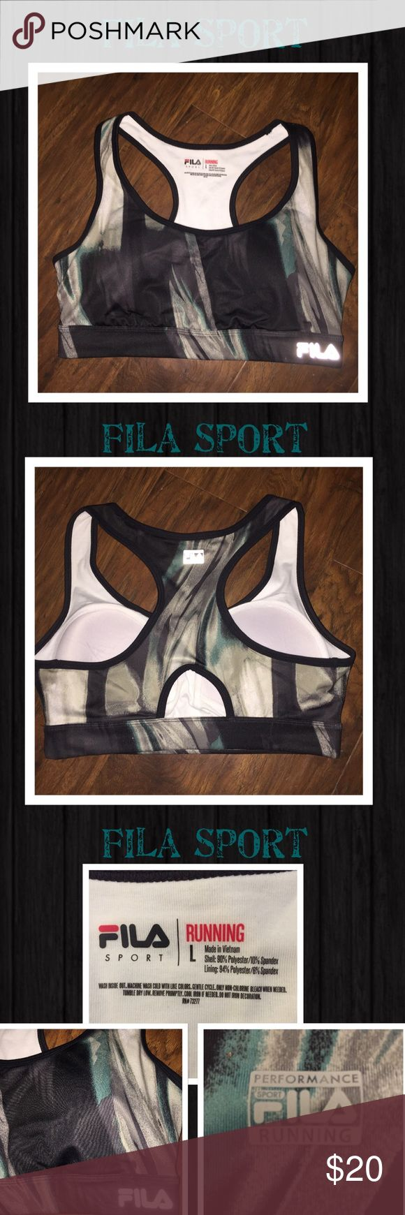 Fila sport performance running large sports bra Made by Fila Sport this is a performance running sports bra size large. Has an edgy painted look with colors of aquamarine, charcoal and heather gray. Fila insignia reflects light. Has soft cups for breasts support and hold firmly in place. Great condition Fila Intimates & Sleepwear Bras