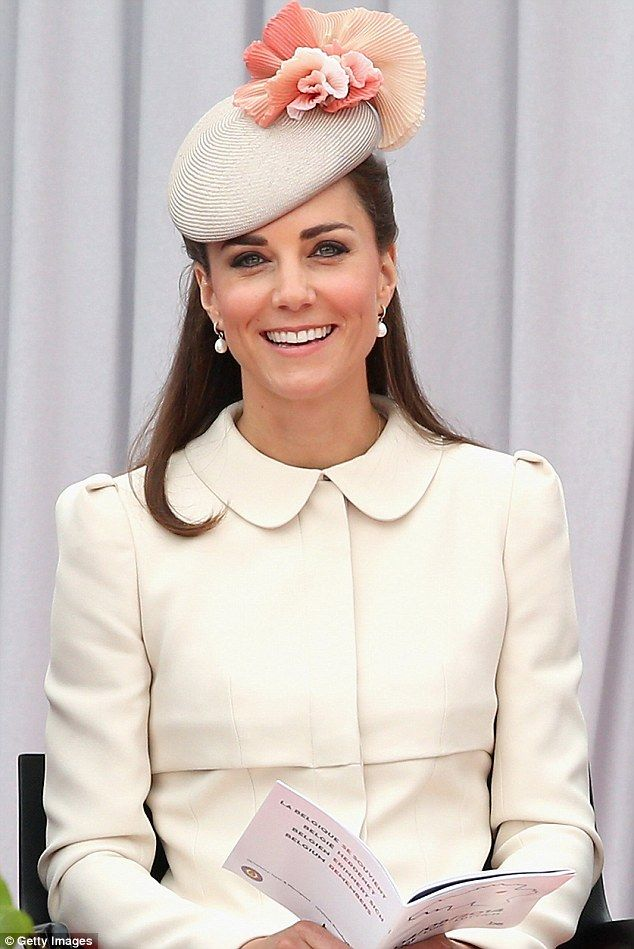 2014: Pearl earrings proved to be the perfect accessory as Kate attended a First World War...
