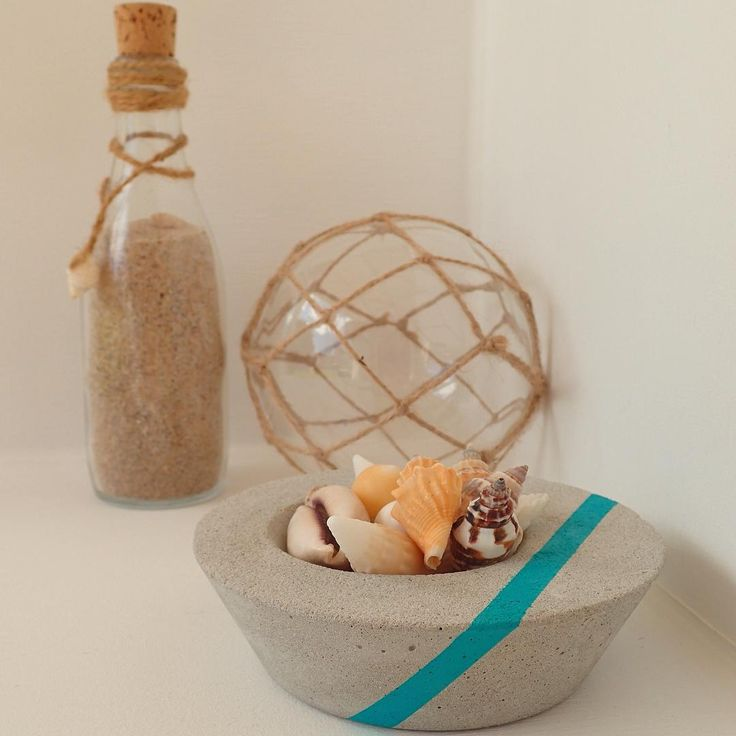 Our Low Set Concrete Trinkets filled with some shells can give your home a beautiful coastal feel. #coastal #shells #concrete #design #sand #home #decor #turquoise