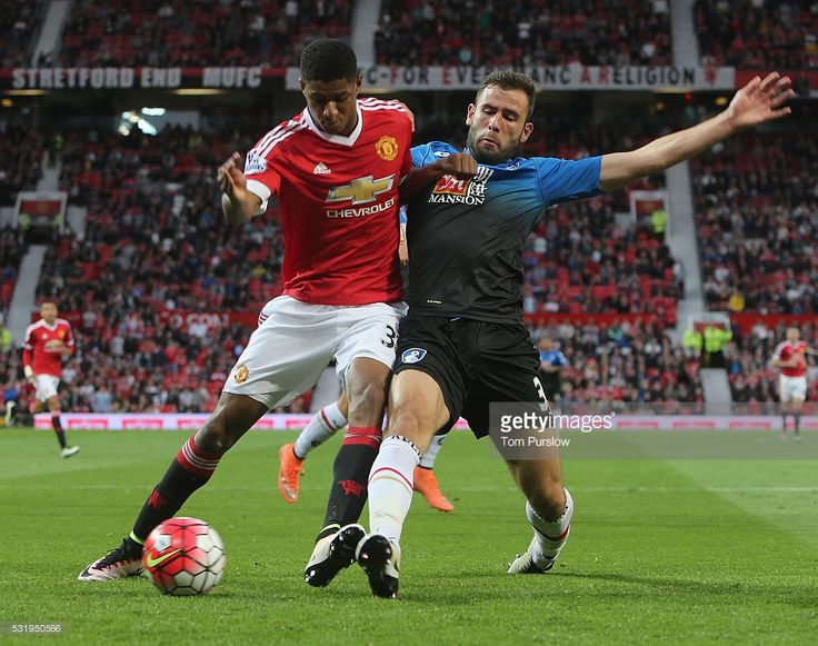 Marcus Rashford of Manchester United in action with Steve Cook of AFC Bournemouth during the Barclays Premier League match between Manchester United and AFC Bournemouth at Old Trafford on May 17, 2016 in Manchester, England.