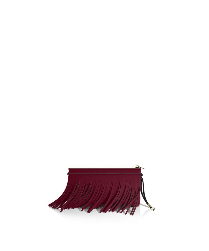 Stand out from the crowd with this fringed clutch. Tough-luxe style with attitude now comes in a range of colours.  Comes with a detachable strap  Size  290 x 150 x 25 mm  160g  Made in Italy  Vegan Friendly  Made from Poly-Lycra Fabric   Metallic Bordeaux