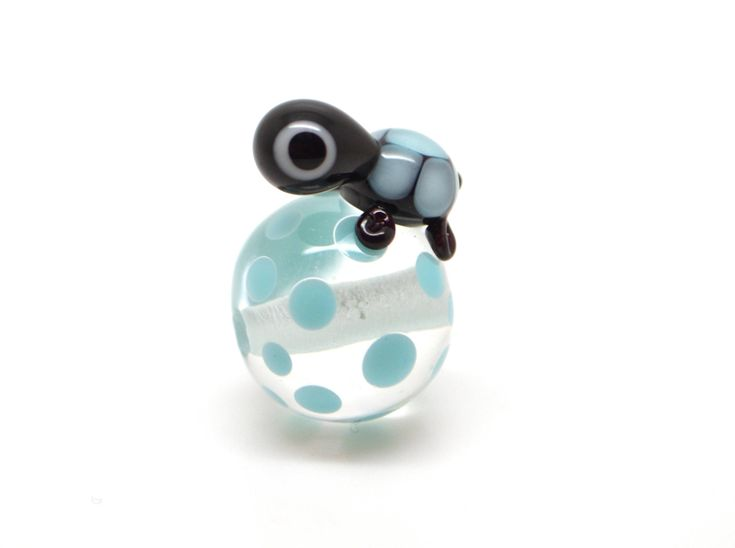 Lampwork bead (small) turtle clear / bright turquoise - 1 piece by Kalivari on Etsy https://www.etsy.com/listing/568348299/lampwork-bead-small-turtle-clear-bright
