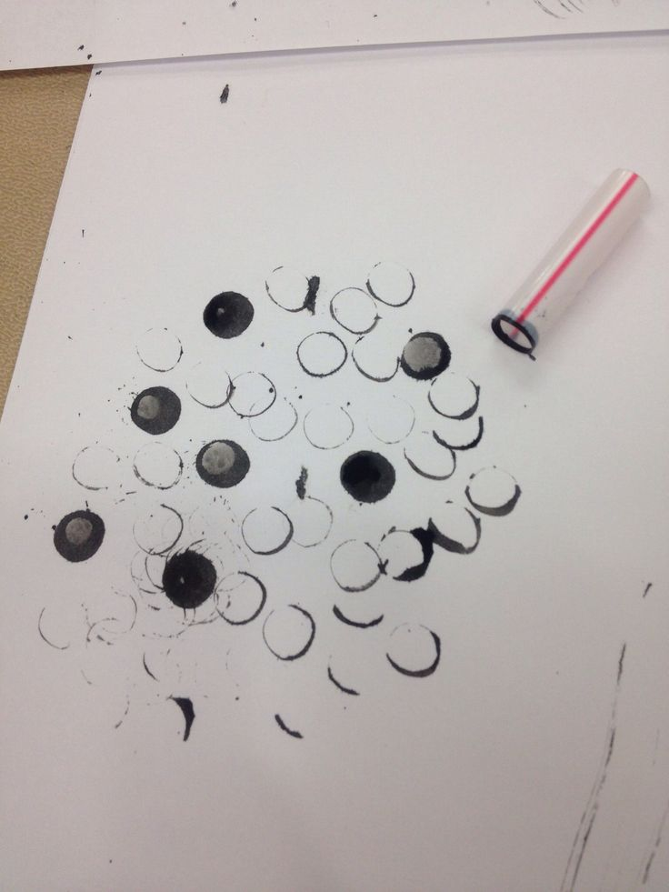 Mark making in art class. Straw and ink=Circles.