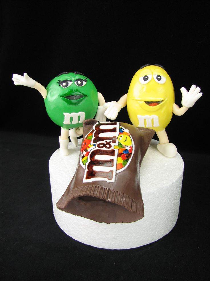 I made this topper before going on my camping trip. The cake making and decorating was being done by another decorator. They were to be put on a 2 tiered cake with M&M's spilling out of the bag.