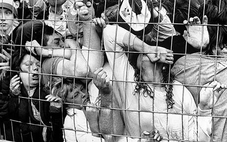 Fans being crushed against the fence in the Liverpool enclosure at Hillsborough during the FA Cup semi-final between Liverpool and Nottingham Forest, 15th April 1989