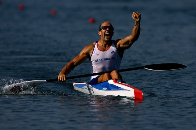 Inspirational Moments: Olympic celebrations - BEIJING - AUGUST 22: Tim Brabants of Great Britain celebrates winning the gold medal in the men's flatwater kayak single (K1) 1000m Men Final at the Shunyi Olympic Rowing-Canoeing Park on Day 14 of the Beijing 2008 Olympic Games on August 22, 2008 in Beijing, China. (Photo by Jeff Gross/Getty Images)