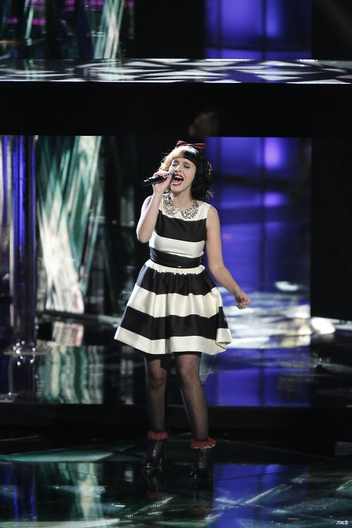 I love Melanie!!!! She is so pretty unique and of course she's a great singer best one in the competition!!!!!!! GO MELANIE !!!!!