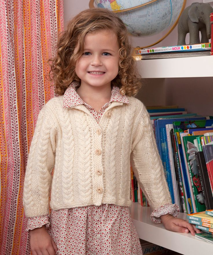 This classic cabled cardigan will never go out of style. Knit it in a neutral colour as shown here and it will be worn with everything in your child's wardrobe.